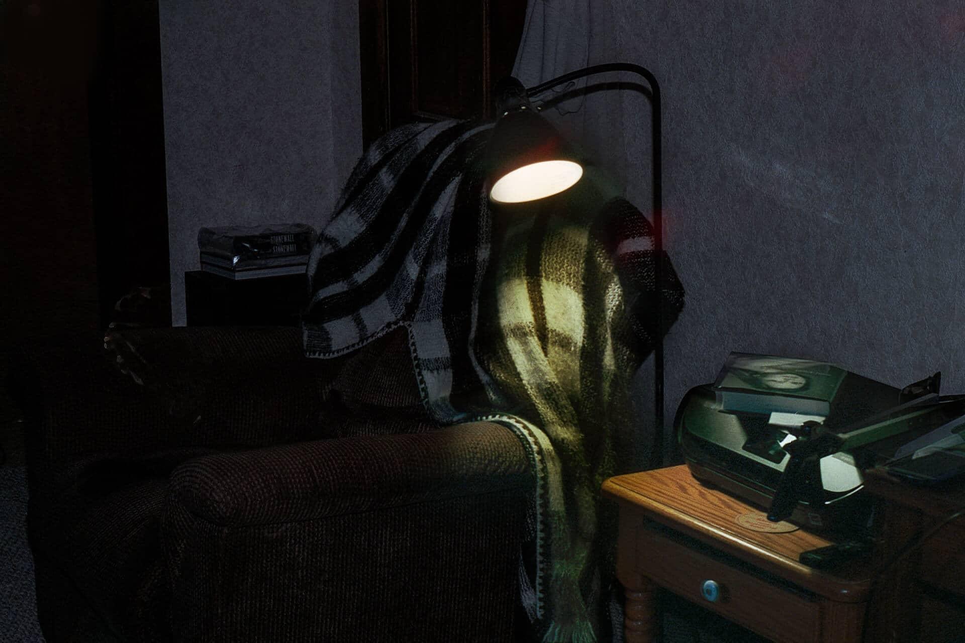 Sofa lit by lamplight